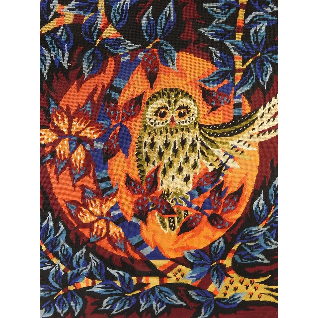 Circa 1970's vibrant needlepoint tapestry of an owl. Mounted stretched over Masonite. Unsigned. Unframed, minor frayed spots.