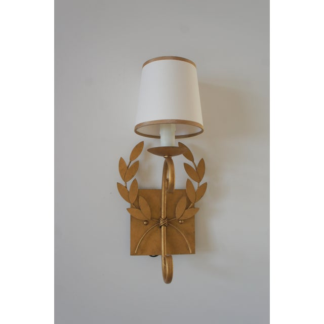 Fantastic Julie Neill design Wreath Sconce in a russet gilt finish. This fine sconce light was handcrafted by Julie Neill...