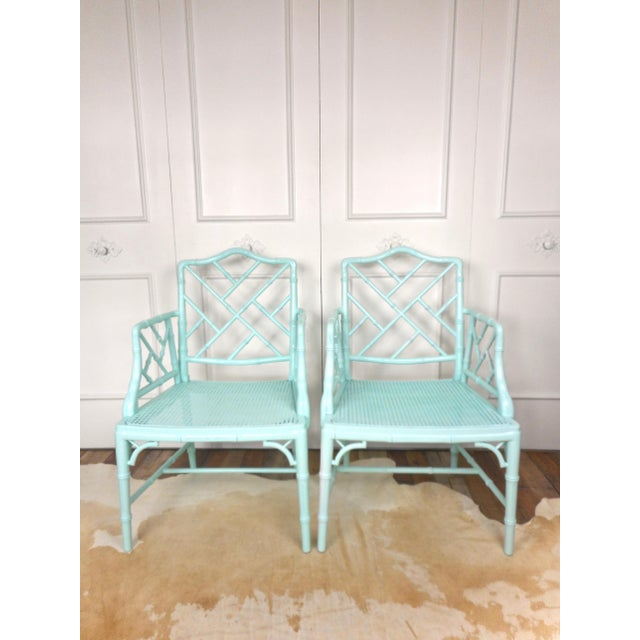Fabulous pair of chinese chippendale chairs. Made of wood with faux bamboo design. Woven seats. Painted pale turquoise /...