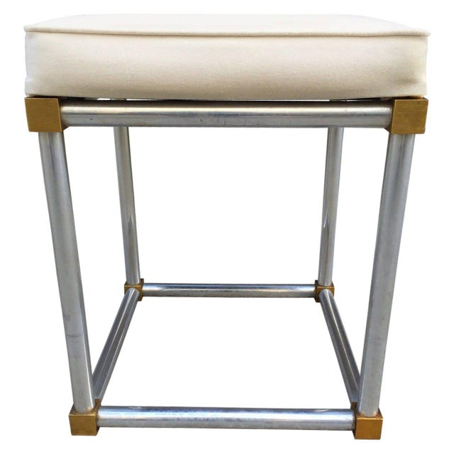 Chrome and brass stool. The seat has a linen blend upholstered seat.