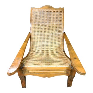 Late 20th Century Vintage British Colonial Teak and Cane Plantation Chair With Swing Arms / Footrest For Sale