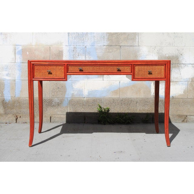 A stunning authentic combed oak, cane, leather top desk by Barbara Barry for McGuire San Fransisco, c. 1970. This is a...