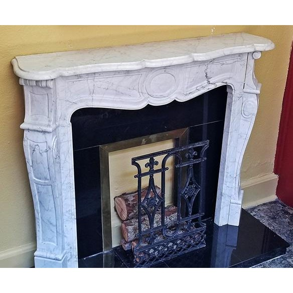 20th Century Irish …….complete white marble fireplace……in 18th Century Style…….with black granite and brass plinth and...
