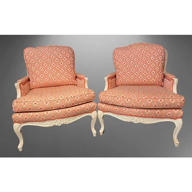 Pair of Louis XVI painted bergère or lounge chairs. Scalamandre upholstery sits on this wonderfully decorative pair of...