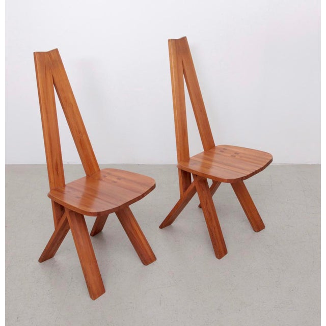 Pair of solid elmwood S45 chairs by Pierre Chapo, produced in the 1970s. The chairs show light marks of age but they are...