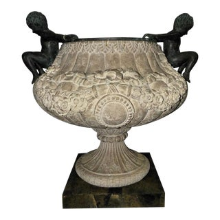 Maitland Smith Neoclassical Cast Stone Urn With Bronze Figures and Marble Base For Sale