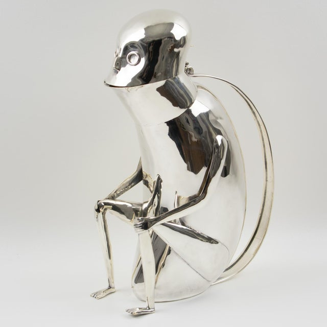 A fun whimsical silver plate metal lidded pitcher designed by Los Castillo, Mexico. Featuring a sitting monkey (sort of)...