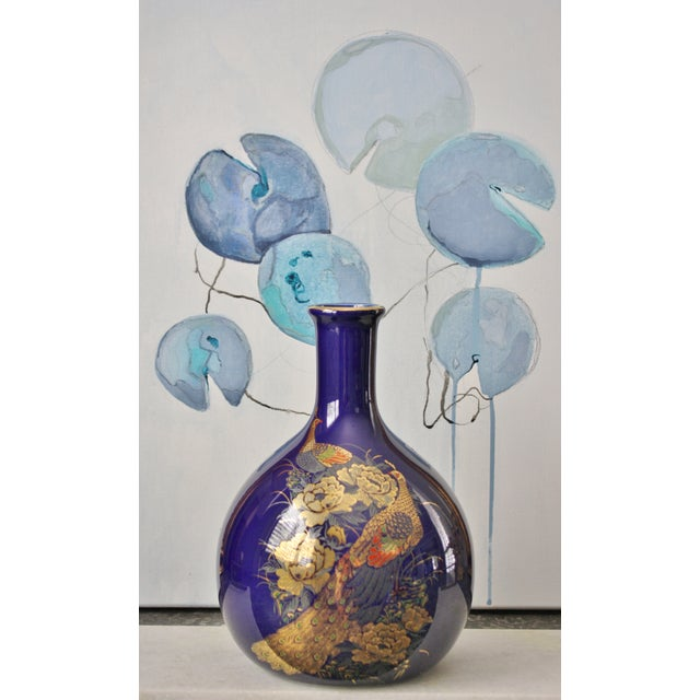 This lovely, vintage, Japanese cobalt blue vase features a pair of peacocks sitting amidst a field of blooming peonies....