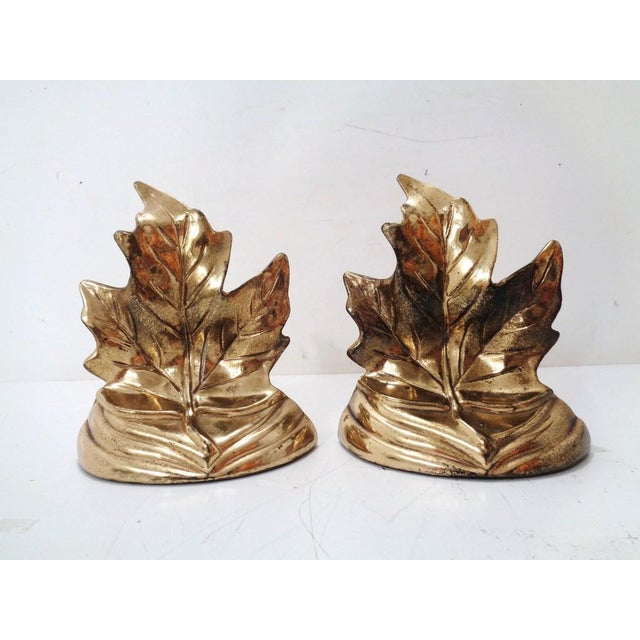 Beautiful pair of vintage maple leaf bookends ~ c. 1950's. Lustrous gold tone metal with substantial weight and felt...