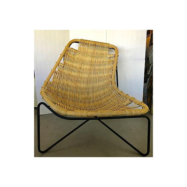 This is a wicker and metal chair designed by Benedetta Tagliabue and made in Spain for Expormim. It is asymmetrical with a...