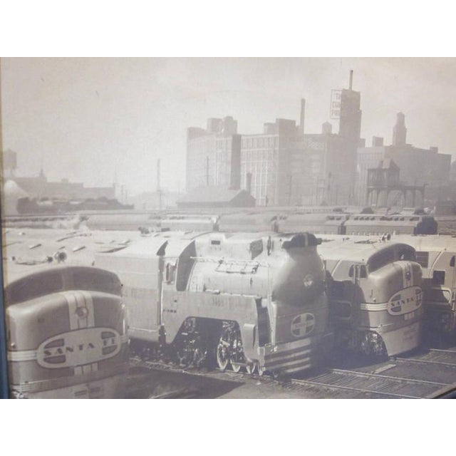 An original sepia toned photo showing the Chicago rail yard and four engines from the Santa Fe railroad, one being a...