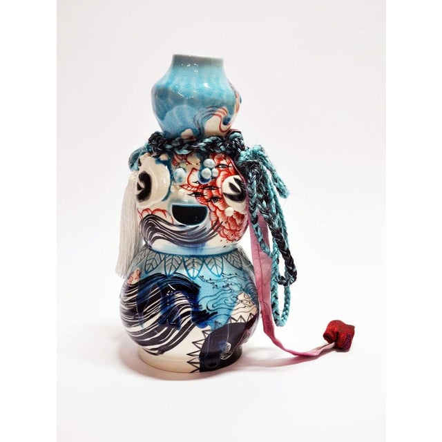 Porcelain, underglaze, glaze, synthetic hair, fabric, found object In her image- and color-saturated paintings and prints,...