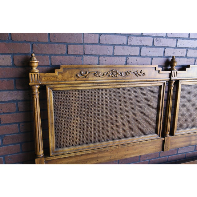 French Regency cane headboard with lovely carved and fluted columns with finials. Cane is in excellent condition. Pre...