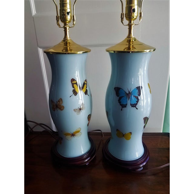 Beautifully decoupaged tall lamps with yellow, blue and green butterflies. The Robin's egg blue color background is a soft...