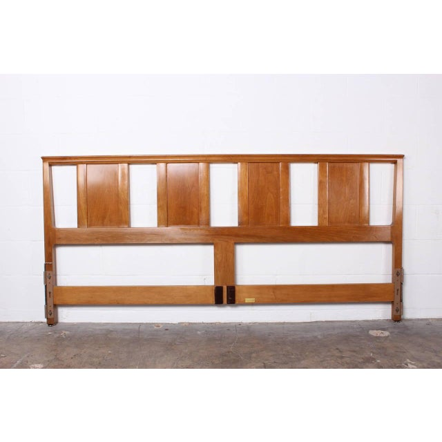 A bleached mahogany headboard designed by Edward Wormley for Dunbar. Matching bedside tables available in separate listing.