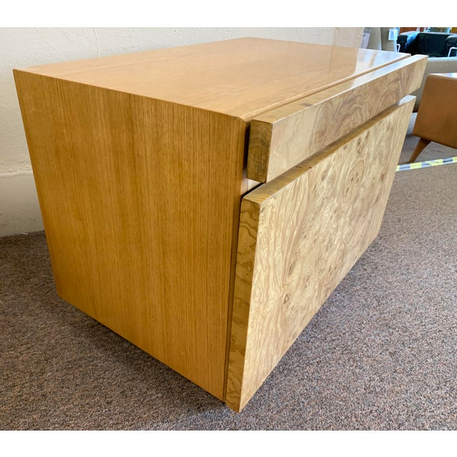 Incredible burled olive wood nightstand, designed by Milo Baughman for Lane. It features a pull out tray with a white...
