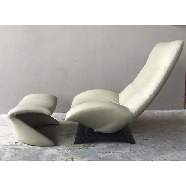 Vintage sleek sexy modernist Artifort leather chair and ottoman sold as found in vintage condition showing some soiling to...