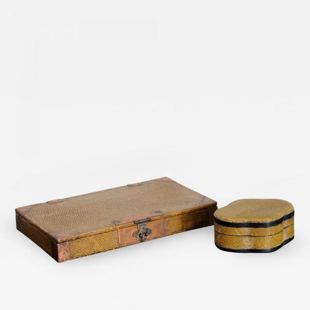 The first a rectangular box with hinges the second a cartouche shaped box with removable top. Small cartouche shaped box...