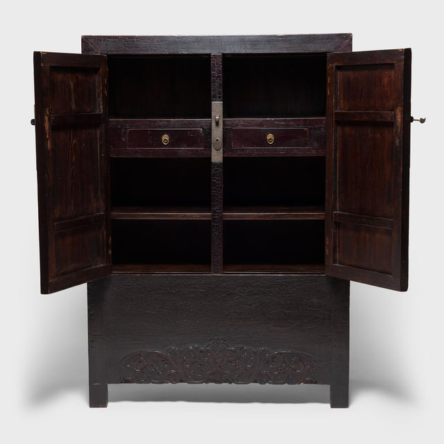 This 19th-century cabinet from Shanxi province epitomizes the austerity of classical Chinese furniture design. Bare of...