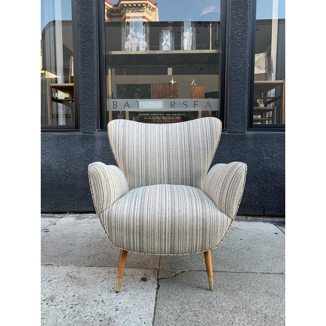 A pair of butterfly chairs in the manner of Paolo Buffa circa 1960. Recently re-upholstered in a beautiful striped fabric....
