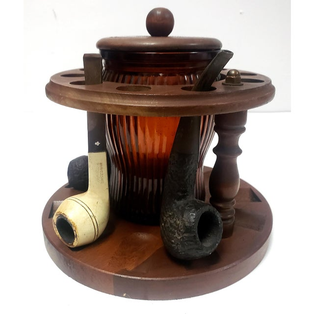 Offered for sale is a 1950s Walnut Dun-Rite Pipe holder Stand for 10 Pipes with a Duraglass amber glass Humidor Tobacco...