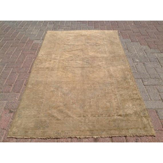 This gorgeous hand-knotted vintage Anatolian area rug is approximately 70 years old in excellent vintage condition. The...