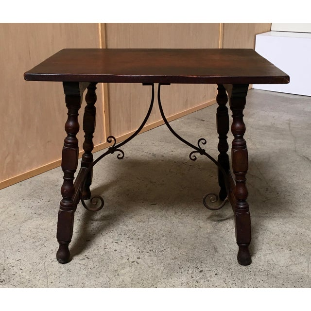Nice antique end table, solid oak with wrought iron stretcher. Wear consistent with age and use.