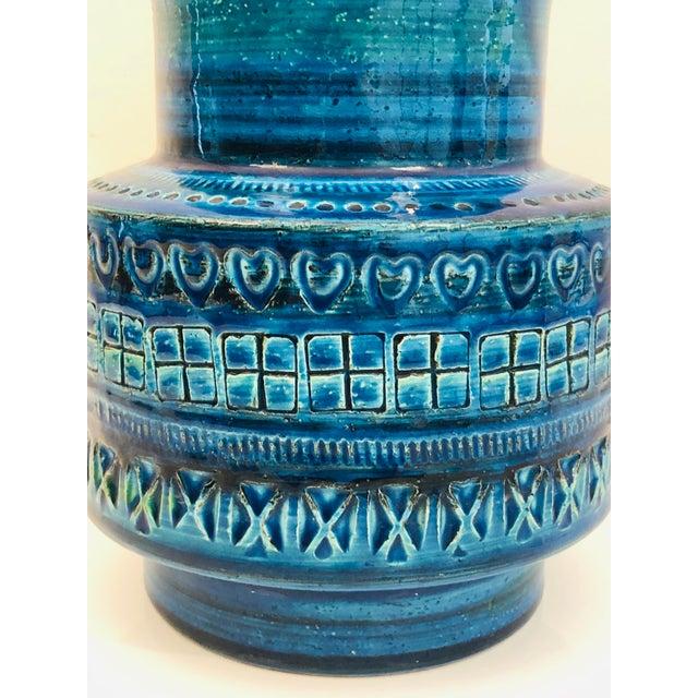 "A fabulous Mid-Century blue ceramic vase designed by Aldo Londi in the iconic ""Rimini Blu"" for Bitossi. The vase..."