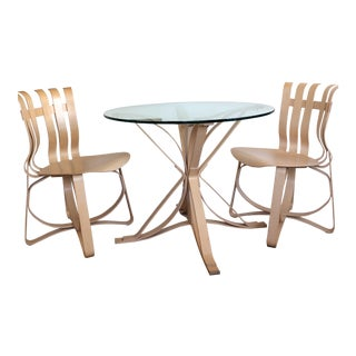 Gehry Face Off Table and Two Hat Trick Chairs