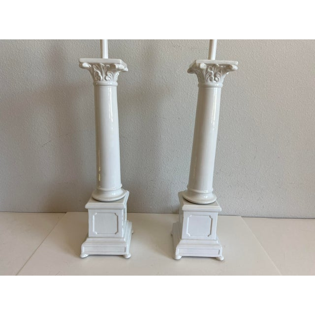 Reading the classics! Gorgeous mid-century oversize Italian porcelain Corinthian column lamps on square plinths with bun...