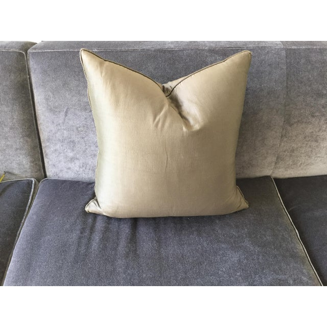 "Beautiful 100% silk pillow in olive color, with self welt and 50/50 fill. Edges show sign of wear. 20"" x 20"" throw pillow..."