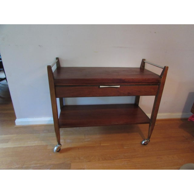 """American mid-century modern bar cart by Lane Altavista furniture made of walnut with inset """"bowties"""" in ebony. In good..."""