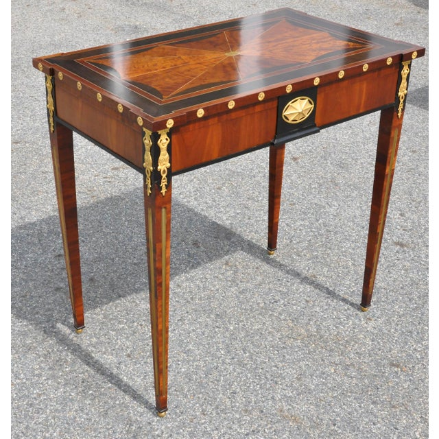 Period Russian neoclassical table with original planter insert. Ebony and figured birch, brass inlay. Top bearing family...