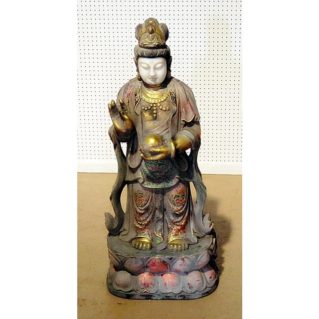 This is a figural Oriental paint decorated statue from the Early 20th Century.
