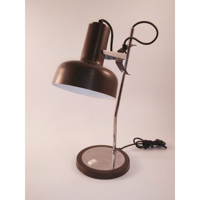 Fantastic desk lamp from Europe. It is chrome and brown enamel and takes a regular bulb. You can tell it is the real thing...
