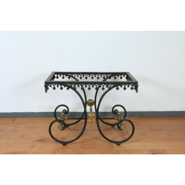Gorgeous vintage wrought iron and brass accent heavy base with beautiful marble top in excellent condition.. No chips or...