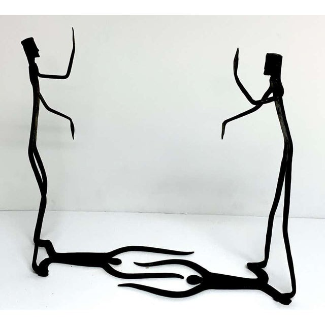 Wrought iron walking man and shadow bookends, each one with fine hand forged detail. The books in the listing are for...