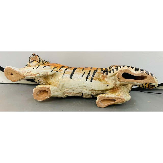 An amazing glazed Italian terracotta tiger statue or sculpture. The beautifully hand painted tiger is in a pouncing...
