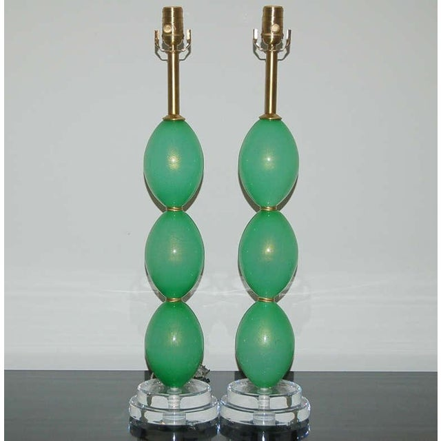Exquisite pair of vintage Murano glass table lamps. The stacked Venetian glass eggs of LIGHT JADE GREEN are loaded with...