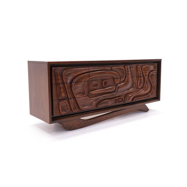 Unique organic shapes are sculpted into the nine drawers of this striking cabinet / credenza / dresser designed by William...
