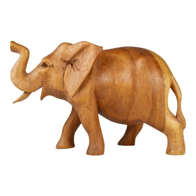 Vintage Hand Carved Wooden Elephant Figurine For Sale