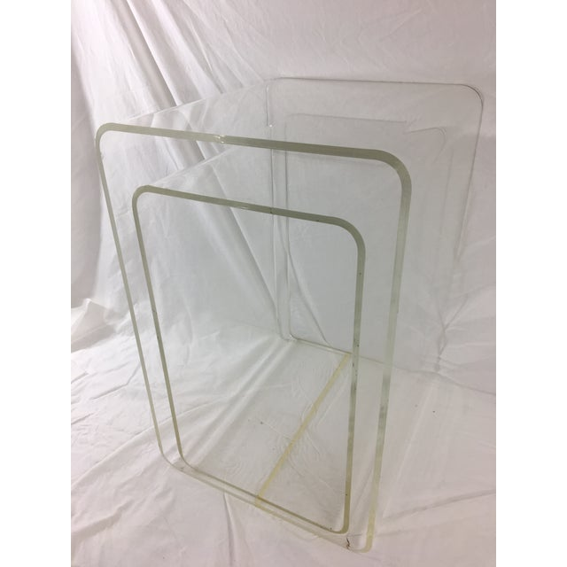 This sleek pair of nesting tables can be used together or separately for one or two transparently cool side tables. The...