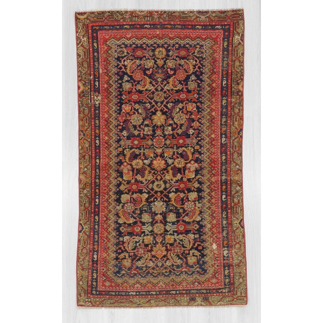 Handknotted antique Persian Malayer rug. In very good condition.