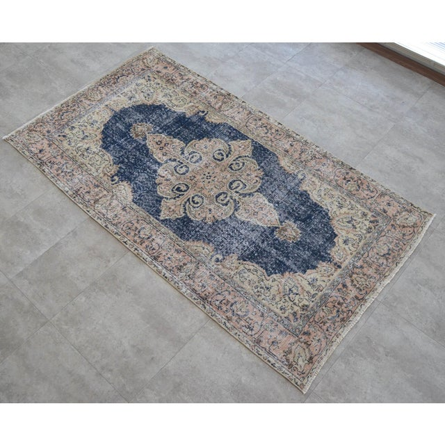 Vintage 1970s distressed Turkish Oushak carpet rug. Distressed aesthetic and character bring out the charm and texture in...