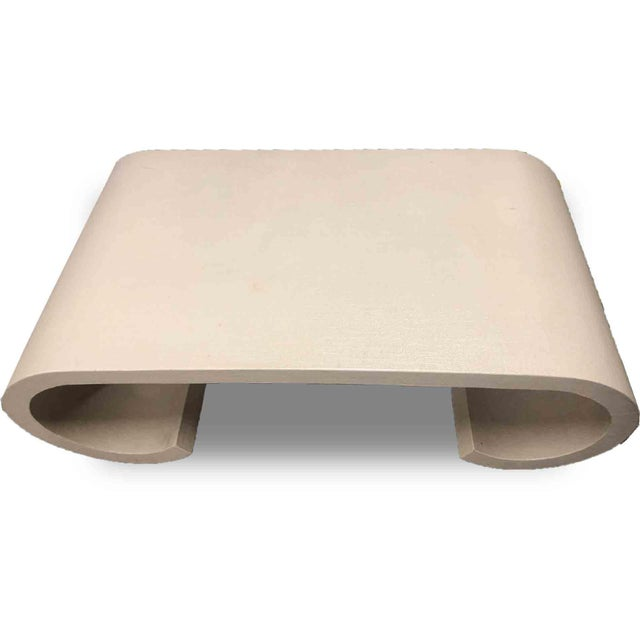 Produced ca. 1970's, this very cool scroll coffee table is in the style of Karl Springer. The table's surface is wrapped...