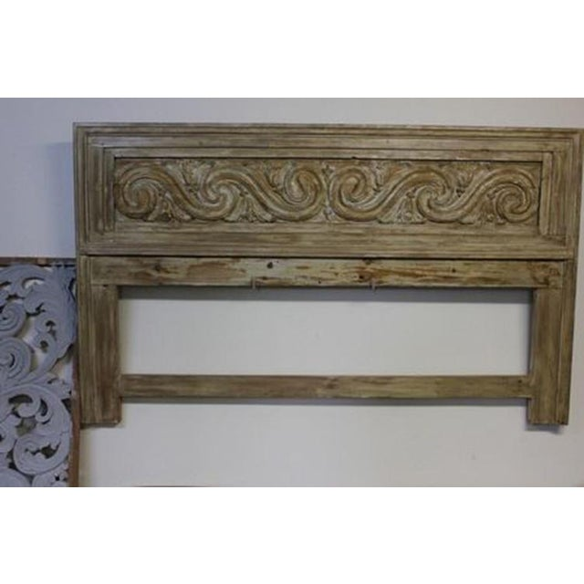 """A beautifully carved wooden headboard. This piece measures: 70-1/2""""w x 38-1/2""""h x 2-1/2"""""""