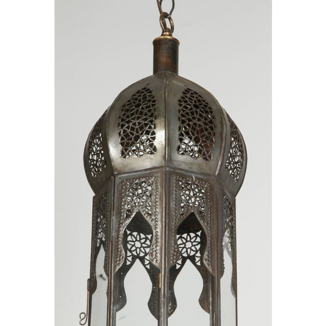 Large pair of Moroccan Moorish metal and clear glass pendant, handcrafted in Marrakesh, Morocco by talented artisans,...