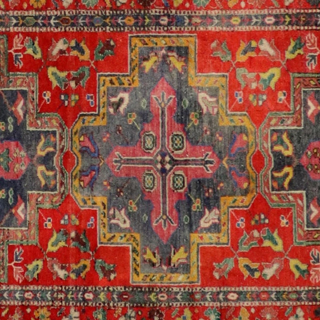 Made with 100% Natural Wool Fiber and hand knotted in Turkey. Its captivating blend of rich reds and deep navy with...