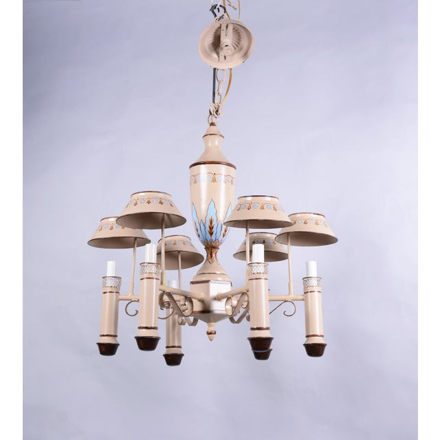 vintage Chandelier with six lamp holders. with shades. Hand painted with designs. Good in every room.