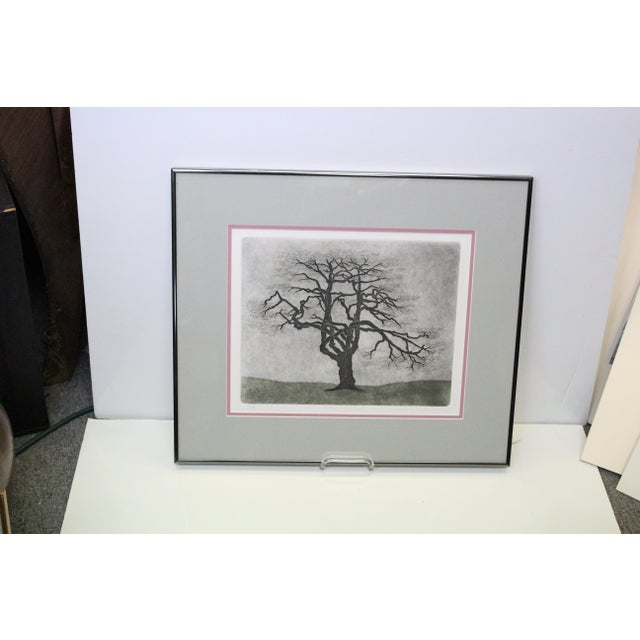 Hand crafted print of a Dogwood tree by P. Donahue. In pink and green mat, glass top, and thin silver frame.